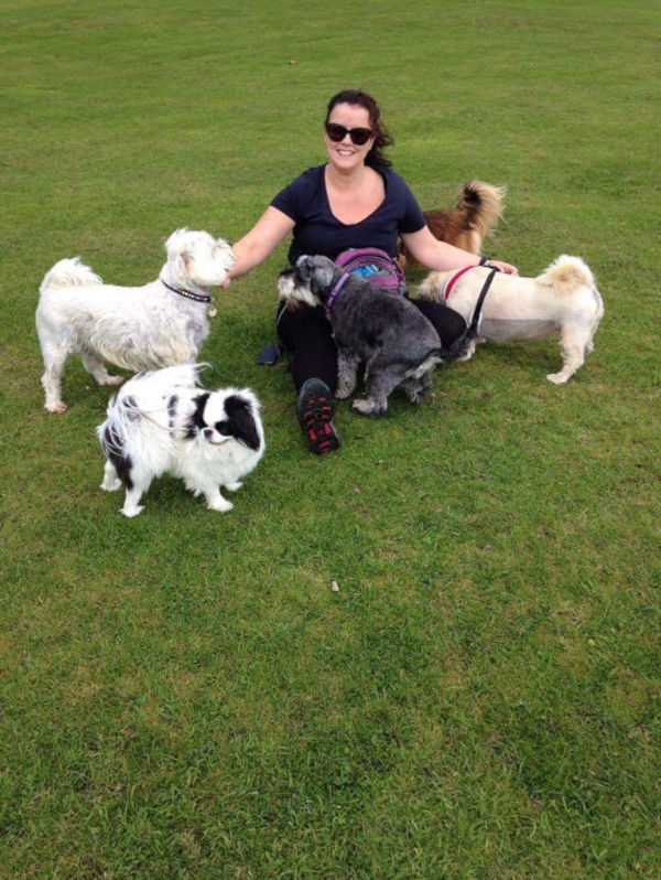 Andrea sitting with dogs